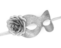 Simple and elegant masquerade mask in metallic silver color. Front surface is covered with silver lace which adds the Venetian mask a beautiful texture.