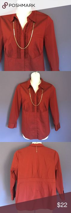 """🎉New Listing🎉 Liz & Me Maroon Button-Down Shirt Maroon is a gorgeous color.  The button down the middle are hidden. The top portion has lovely pleated detailing, while the bottom is plain.  Shirt looks great with black pants or skirt. Material:  65% Cotton/30% Polyester/5% Spandex. Measurements:  Length - 28.5""""/Bust - 24""""/Waist - 23"""" Liz & Me Tops Button Down Shirts"""