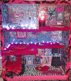 Monster High DIY house made out of a bookshelf...fake fur carpets and decoupage/wrapping paper walls