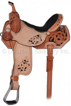 Pozzi Pro Barrel Racer with partial floral tooling & a black background.