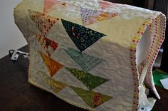 Quilted sewing machine cover.  Flying geese.