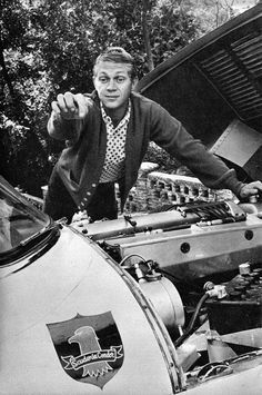 "Steve McQueen and his 1957 Jaguar XKSS at his Laurel Canyon home pointing at his first production company logo ""Scudervia Condor"" 1958 © 1978 Gene Trindl - Image Steve Mcqueen Cars, Steve Mcqueen Style, Steven Mcqueen, Jaguar, Vintage Hollywood, Classic Hollywood, Hollywood Men, Hollywood Glamour, Hollywood Stars"