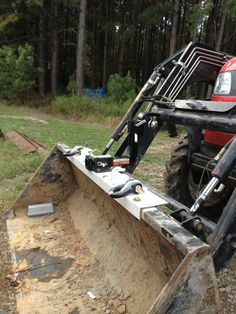 Tractor bucket chain, D-ring, tow bar add on, used a 3/16 thick piece of angle iron to help support the load and strain across the bucket. The hitch is from a harbor freight ATV and comes with a drop