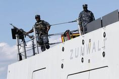 Sailors stand watch on the stern of the USS Zumwalt while at dock at the naval station in Newport, R.I.