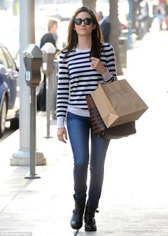 Stylish errands: The former Phantom Of The Opera star donned a pair of denim skinny jeans,...