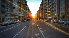 Tell them the fairytale gone bad... #sunset #avenue #street #city #cityscape #landscape #sun #sky #hdr #light #depth #cars #people #like4like #likeMe #l4l #marDelPlata #mdq #mdp #argentina #arg #saturated #vignette #architecture