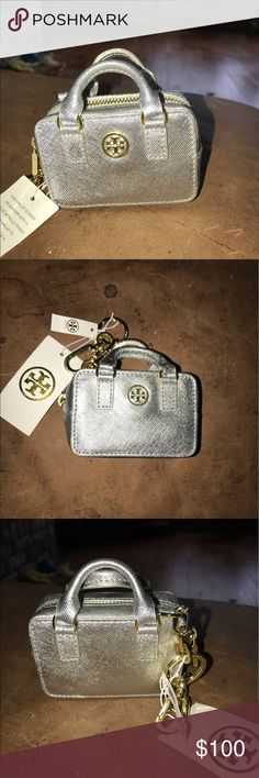 TORY BURCH/ KEY FOB/COIN PURSE in GLITTERY SILVER This is BRAND NEW WITH THE TAGS ON!! This is a Key Fob/ coin purse. It can actually hold coins while looking stylish on your purse!! This mini TB bag will spotlight any purse that you put in on or even spotlight your keys and keep you coins in it. It looks like a exact miniature of a real TB purse. Tory Burch Bags Clutches & Wristlets