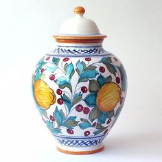 Frutta Venezia Canister | This canister was expertly painted by Stefano Bartoloni. It exudes Italian color and sophistication. Remove the top to make a stunning vase for flowers. Limited availability.9w x 14h