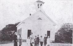 Students outside Quissett school around 1910.