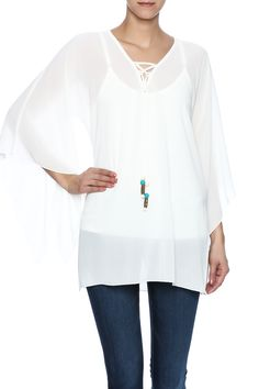 Cream boho shirt with acream tank underneath 3/4 sleeves and a lace up v-neckline.  Cassidy Tunic by Mesmerize. Clothing - Tops - Blouses & Shirts Clothing - Tops - Long Sleeve Florida