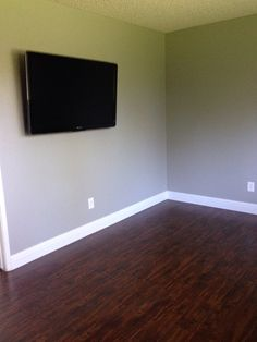 Dark floors, high baseboards and gray paint (Valspar Woodlawn Colonial Gray) Our newly modeled floors!