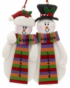 This snow couple grandma and grandpa have plenty of space on their scarves to let us write all the names of their precious grandchildren!  This ornament is made with love out of clay and is very colorful.  Buy it now for $13.95 at www.ornamentshop.com.