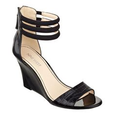 """A snake-embossed strap brings an exotic flair to our Floriscine open toe wedge sandals topped with a trio of ankle straps. Back zip for easy on/off. Padded footbed for all-day comfort. Leather upper. Man-made lining and sole. Imported. 3"""" wedge heels. Wedges and sandals."""