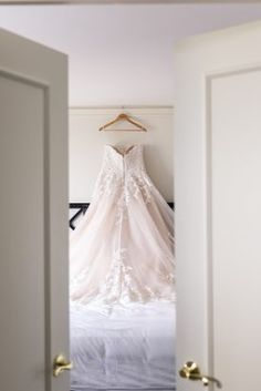 wedding dress photos  from navy and coral Virginia wedding at Fort Myers Officers Club  by Photography by Marirosa