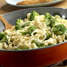Broccoli, egg noodles, sour cream, onion, Parmesan cheese and a creamy chicken sauce make an irresistible marriage.