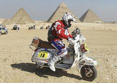 Andrea Revel Nutini of Italy prepares to race on his Piaggio Vespa bike at the start of the International Cross Country Rally of the Pharaohs at the Pyramids Plateau in Giza. Piaggio Scooter, Vespa Ape, Vespa Lambretta, Vintage Vespa, Motor Scooters, Vespa Scooters, Scooter Images, Lml Star, Custom Vespa