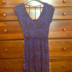 Blue Cheetah Print Dress Looking for more animal print in your life? This blue cheetah print dress is just the thing. It's 100% rayon. It's a v neck style short-sleeved dress with an awesome caged back. And it's in great condition, it's been worn only once or twice Dresses