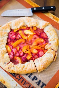 An easy recipe for free form rustic strawberry peach tart.