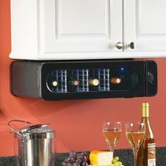 """Under Cabinet wine fridge.  Handy to keep a couple bottles within easy reach while hiding the """"big"""" wine fridge somewhere where space is less of a premium than the kitchen.  Smart."""