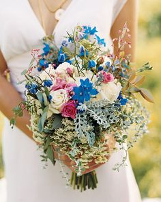 Bride Chloe's mother designed this colorful bouquet, which consists of flowers and herbs plucked from Pearbrook: blue delphiniums, coral bells, artemisia, Queen Anne's lace, and pink and white roses among them.