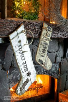 Old sign styled reclaimed wood Christmas stockings on a wreath filled fireplace mantel using Funky Junk's Old Sign Stencils | funkyjunkinteriors.net