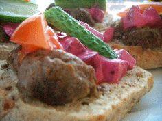 Kottbullsmacka or kottbullssmorgas recipe. Swedish meatball sandwich with beetroot salad, tomato and pickles.