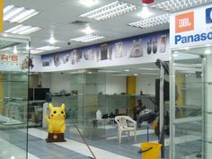 Avisos interior tienda Tacheers