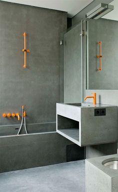 concrete bathroom. color accents.