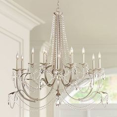 This large, twelve-light chandelier has a classic look that glistens in versatile silver leaf finish and sparkling crystal beads. Entry Chandelier, Chandelier Lighting Fixtures, Silver Chandelier, Foyer Lighting, Chandelier In Living Room, Glass Chandelier, Light Fixtures, Chandelier Ideas, House Lighting