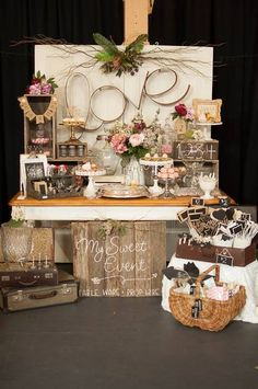 Rustic/shabby chic/vintage/wedding/event/suitcases/wooden risers/cake stands/compotes/bunting/metal love sign/wooden doors reception/table numbers all available at mysweeteventhire .com.au