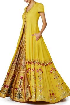 Anita Dongre presents Printed long jacket and lehenga set.this yellow puja look by AayuShi Indian Fashion Dresses, Indian Gowns, Indian Attire, Indian Ethnic Wear, Pakistani Dresses, African Fashion, Indian Wedding Outfits, Indian Outfits, Indian Weddings