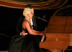 Hands on: As Gaga played the piano, Bradley walked around to sit at her side, an arm around her waist Best Actress, Best Actor, Vice Documentary, One Twitter, Mahershala Ali, Ready Player One, Best Director, Best Supporting Actor, Playing Piano