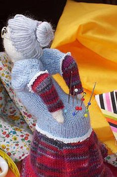 Old Lady knitted pin cushion. Would love to find the pattern for this.