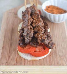 Suya -- spicy grilled beef skewers with peanut coating