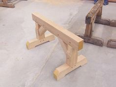 Timberframe Saw Horse. [an exceptionally stable sawhorse!  This style of leg would work well with a large slab built table.]