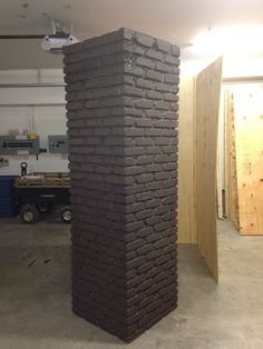 Haunted House prop. 8 feet tall by 2 feet wide halloween brick tower made by painting acitone on foam in a brick pattern. I made 2 for my 2013 haunt.
