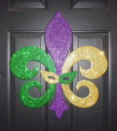 good size for wall decor, but in your colors and no mask.  You could make 20 of these in Red and Gold beads on cardbord so they are lightwight.  Hang, prop, whatever works for venuFleur de Lis Mardi Gras by RKDragonfly on Etsy. 54.95, via Etsy.