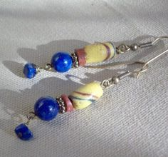 not very exciting earrings, but I have these materials. ETHIOPIALapis and  Trade Bead earringsJewelry by riverpebble, $28.00