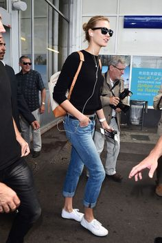 Jeans, kicks, backpack.