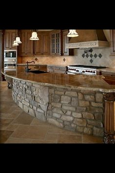 Love the stone and love how it sections the kitchen off so nicely while still leaving it with such an open feeling.