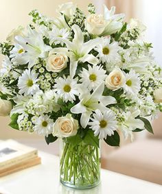 Sincerest Wishes White Arrangement Express your heartfelt wishes with our elegant all-white arrangement of roses, lilies, stock, daisy poms and monte casino. Church Flowers, Funeral Flowers, Flower Bouquet Wedding, Rose Bouquet, Elegant Flowers, Beautiful Flowers, 800 Flowers, Send Flowers, Flower Centerpieces