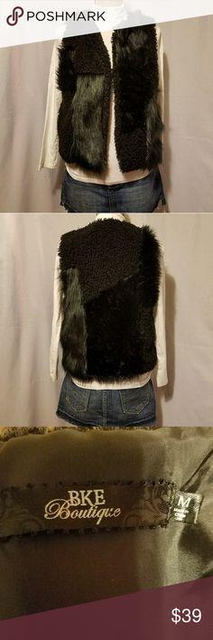 "BKE Boutique Faux fur vest. Beautiful bke boutique faux fur vest.Size medium.Shoulder to bottom 20"" long.Used  some wear on the fur not noticeable.Make an offer. BKE Jackets & Coats Vests"