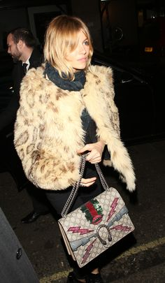 Spotted in London, Sienna Miller carrying a Gucci Dionysus embroidered bag with mouth and lightning appliqués and trompe l'oeil sequin ruffles by Alessandro Michele.