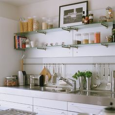 Kitchen sink area- there are few things nicer than an organized kitchen storage area