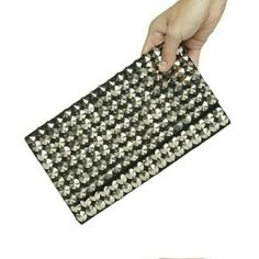 "BCBGeneration 'Queen Bee' silver studded clutch Clutch with silvertone conical studs, magnetic snap closure, new in packaging with tags,  material side is blavk, lined .....measures 9.5"" w x 6""h. x .5"" d. .....tu4 BCBGeneration Bags Clutches & Wristlets"