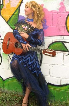 Que guitarrista , que Mujer