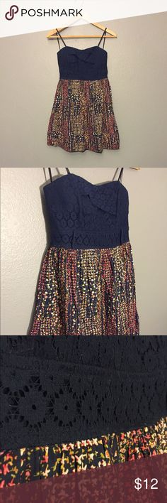 Navy floral strapless dress Crochet detailing up top, small floral pattern on the skirt - worn once! It is sized as a juniors dress size 7, but in women's is around a 4 or 6. City Studio Dresses Strapless