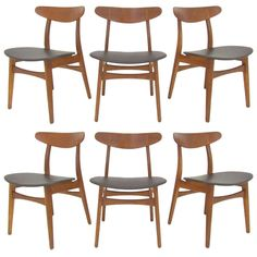Set of Six Danish Teak & Oak Dining Chairs by Hans Wegner ca. 1960s | From a unique collection of antique and modern dining room chairs at https://www.1stdibs.com/furniture/seating/dining-room-chairs/