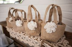 Burlap baby shower favor treat bags are filled with prizes for winners of games