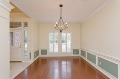 4407 Broadleaf St Kingwood, TX 77345: Photo Plantation shutters and hardwoods in elegant dining room